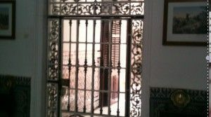 The beautiful entrance wrought iron gate .
