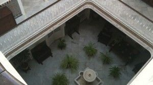 The splendid covered patio of the XIXth century andalusian palace .